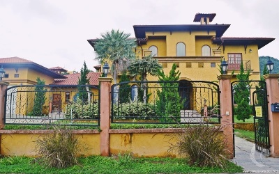 Luxury yellow villa with natural environment