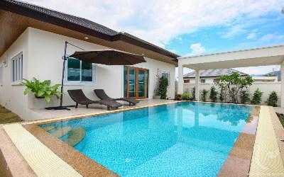 Villa avec piscine à débordement, financement possible