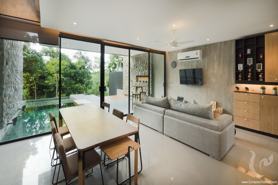 Living room with large window walk through swimming pool